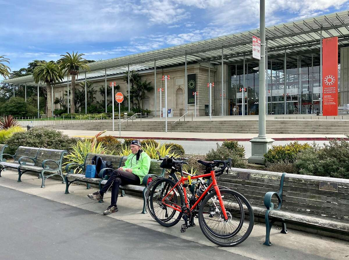 Philip Hartlaub, 86, eats lunch in front of the California Academy of Sciences after a bike ride from Alameda to Golden Gate Park.