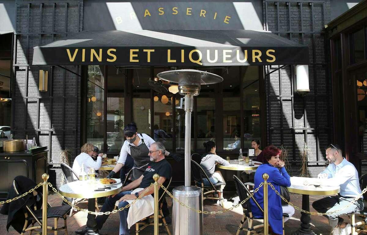 Patrons dine at Brasserie Mon Chou Chou Monday.