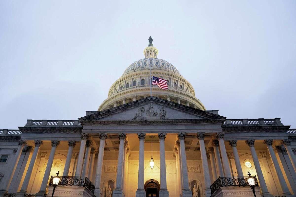 The U.S. Capitol at dusk in Washington, D.C., U.S., on Wednesday, Feb. 10, 2021.