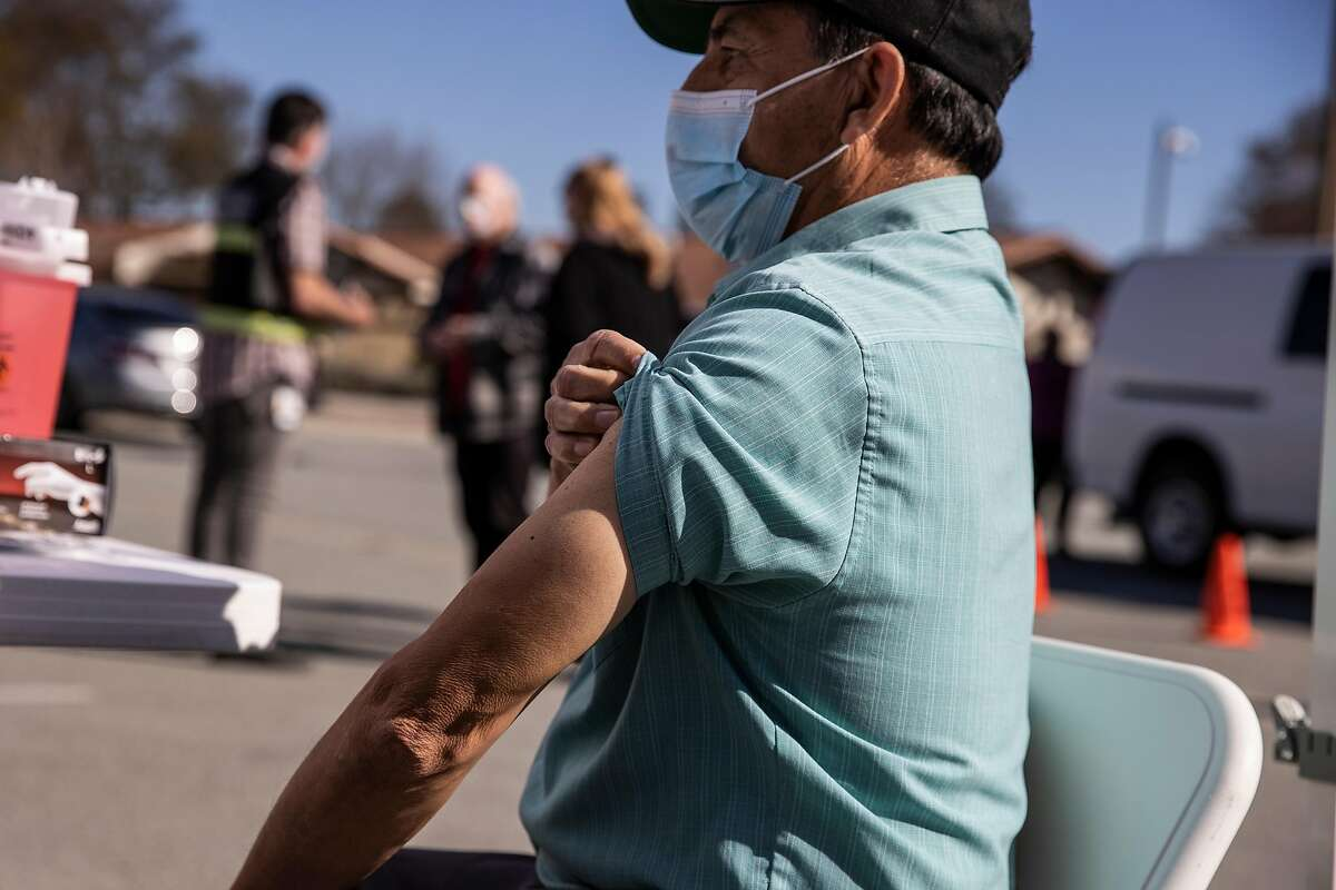 Felix Solorio, 72, pulls up his shirt sleeve while waiting to receive his first dose of Moderna COVID-19 vaccine during a pop-up vaccination clinic at the Gilroy Senior Center in Gilroy, California Wednesday, Feb. 17, 2021.