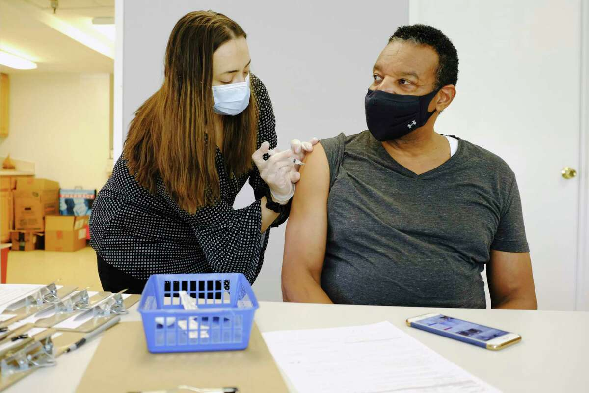 Steve Anthony, right, receives his second dose of the Moderna Covid-19 vaccine from Laura Ordway, the public health pharmacist at The Collaboratory, Albany College of Pharmacy and Health Sciences, on Wednesday, March 10, 2021, in Albany, N.Y. (Paul Buckowski/Times Union)