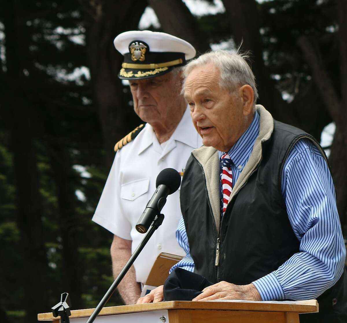 """Richard """"Chief Johnny"""" Jongordon makes opening remarks at the USS San Francisco Memorial ceremony on Memorial Day 2018, with Capt. Stan Ellexson next to him."""