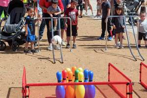 Spring break camp at Centennial Plaza 03/10/21 included recycled bowling as well as fun in the splash pad. Tim Fischer/Reporter-Telegram