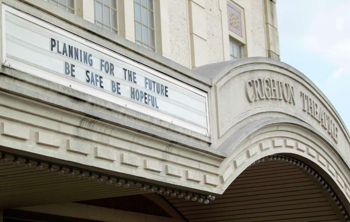"""The marquee in front of the historic Crighton Theatre reads """"Planning For The Future Be Safe Be Hopeful,"""" Wednesday, April 8, 2020, in Conroe. The Foundation that operates the theater announced it would keep limited seating through June 1."""
