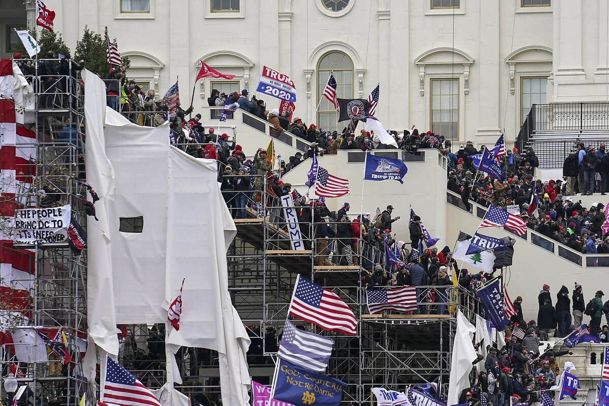 Insurrectionists loyal to President Donald Trump riot outside the U.S. Capitol on Jan. 6.