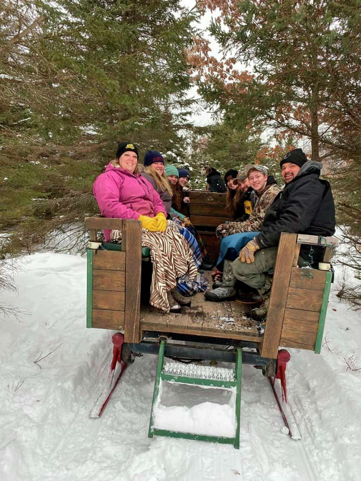 During the winter months, Mecosta County families can enjoy a sleigh ride at Four Green Fields. The farm also offers a warming area, complete with a firepit and warm drinks. (Courtesy photo)