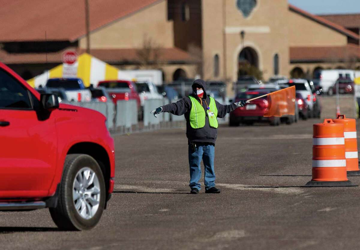 Traffic is directed into lanes for the second dose of the Pfizer COVID-19 vaccine during the first day of the second dose vaccinations at the Ratliff Stadium Mass Vaccination Site on Tuesday, March 2, 2021 in Odessa, Texas. ( Jacob Ford/Odessa American via AP)