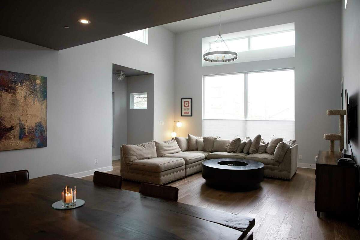 The living room in this Clay Street town house is located on the second floor and opens into the kitchen and dining area.
