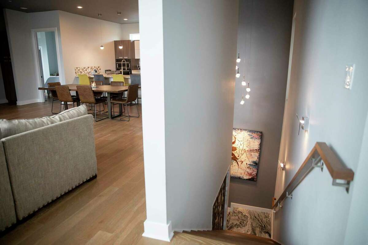 The upstairs living room and open kitchen floor plan offer spacious living in Micah Harper's town house.