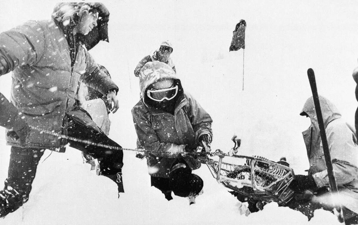 Rescue workers recover a body on April 2, 1982, buried in the parking lot of the Alpine Meadows ski resort after an avalanche that killed seven people rolled through the area.