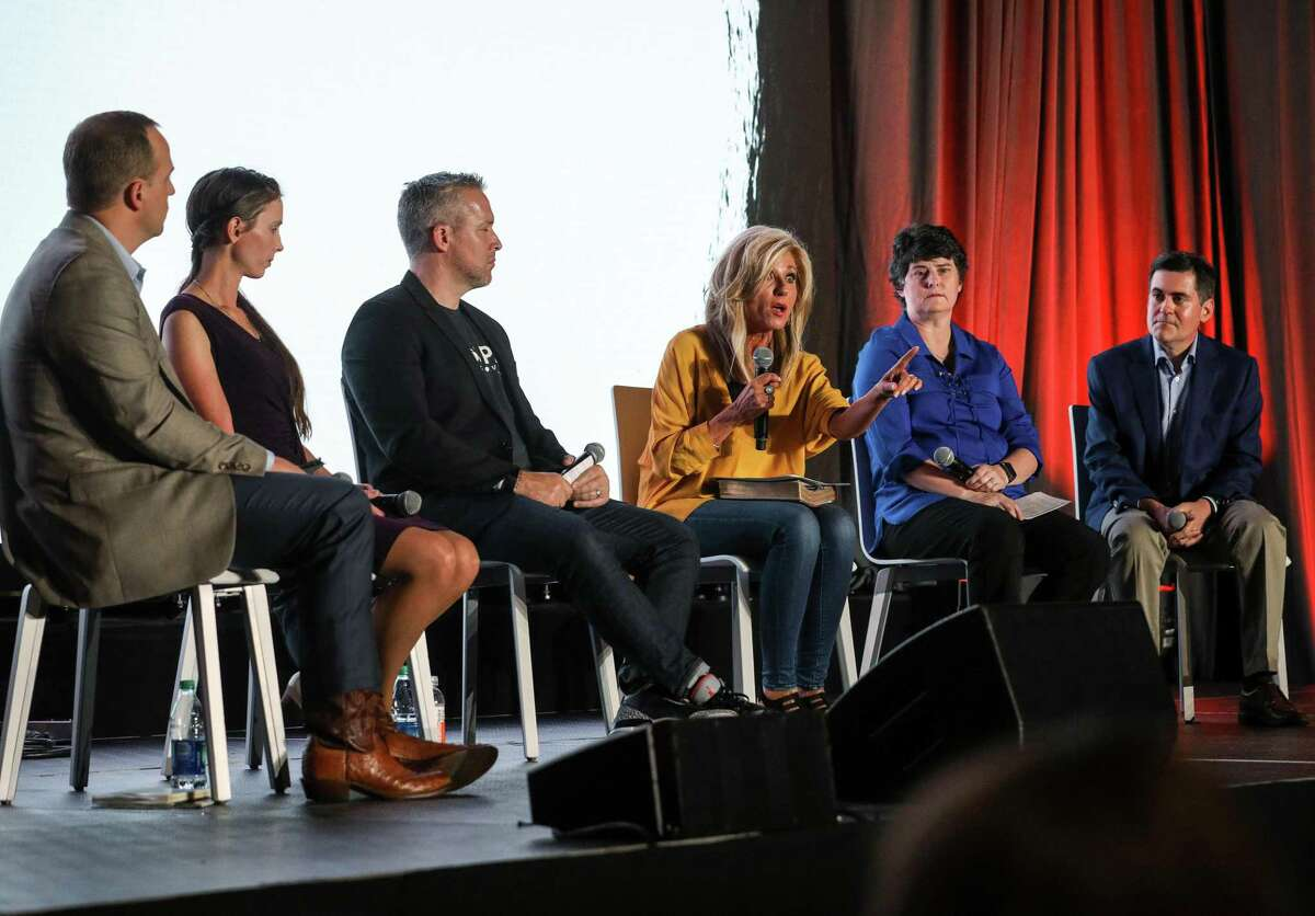 Beth Moore, third from right, speaks about sexual abuse as Phillip Bethancourt, from left, executive vice president of the Ethics and Religious Liberty Commission of the Southern Baptist Convention, Rachael Denhollander, an abuse survivor, J. D. Greear, president of the SBC, Susan Codone, an abuse survivor, and Russell Moore, president of the Ethics and Religious Liberty Commission of the SBC, listen during a panel discussion about sexual abuse and the SBC, on the eve of the SBC's annual meeting on Monday, June 10, 2019, in Birmingham.