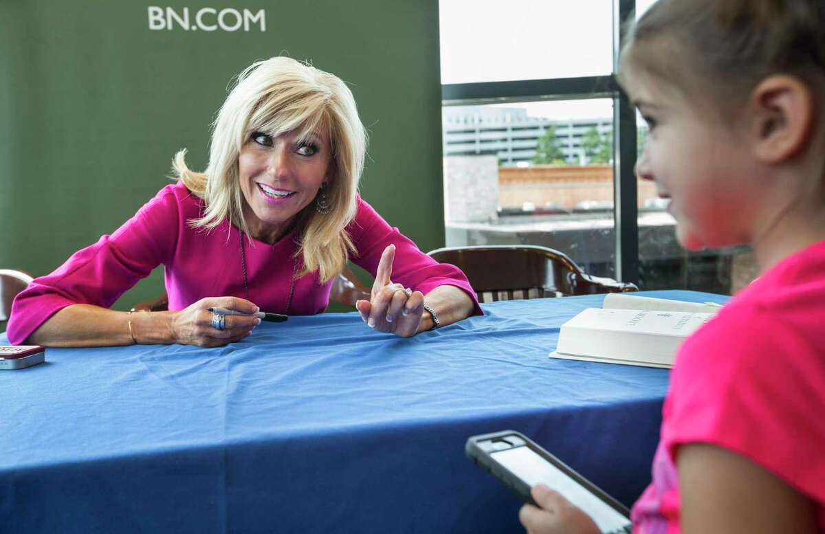 Author Beth Moore talks to Addyson Agold as signs her new book on its release day at Barnes & Noble on Tuesday, Sept. 20, 2016, in The Woodlands. Moore, a nationally known evangelical leader based in Houston, has just written her first novel. ( Brett Coomer / Houston Chronicle )