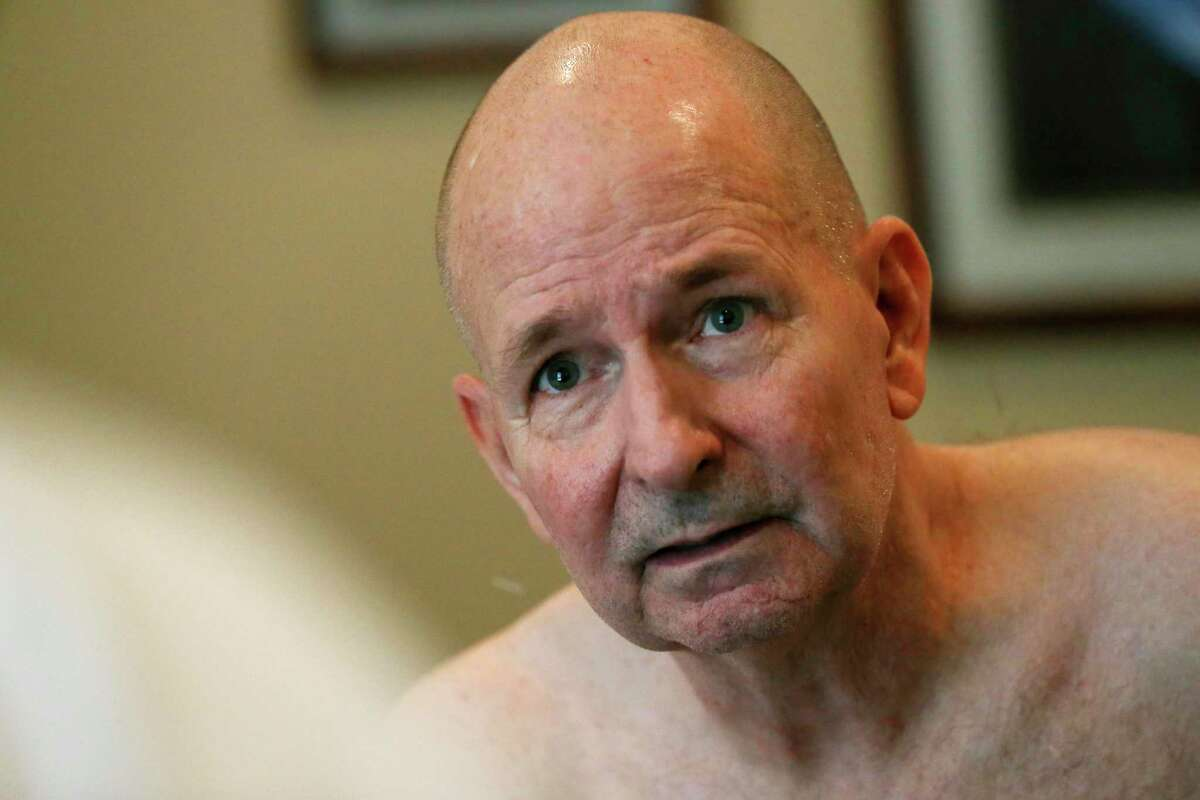 David K. Winnett, Jr., of New Braunfels, listens as acupuncturist Michael Callaghan explains pain relief treatments, Monday, May 7, 2018. Winnett, 63, is a former Marine captain with 100 percent disability due to Gulf War Illness created by exposure to nerve gases and other toxic chemicals. Winnett, of New Braunfels, is a paraplegic after surgery related to a service-related back ailment.