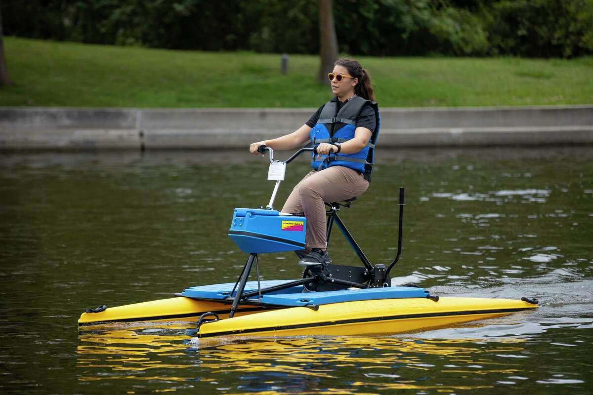 Township officials credited the vigorous marketing campaign touting enhanced safety protocols for a record year of watercraft rentals in 2020. In this June 2020 file photograph, a woman peddles through The Woodlands Waterway.