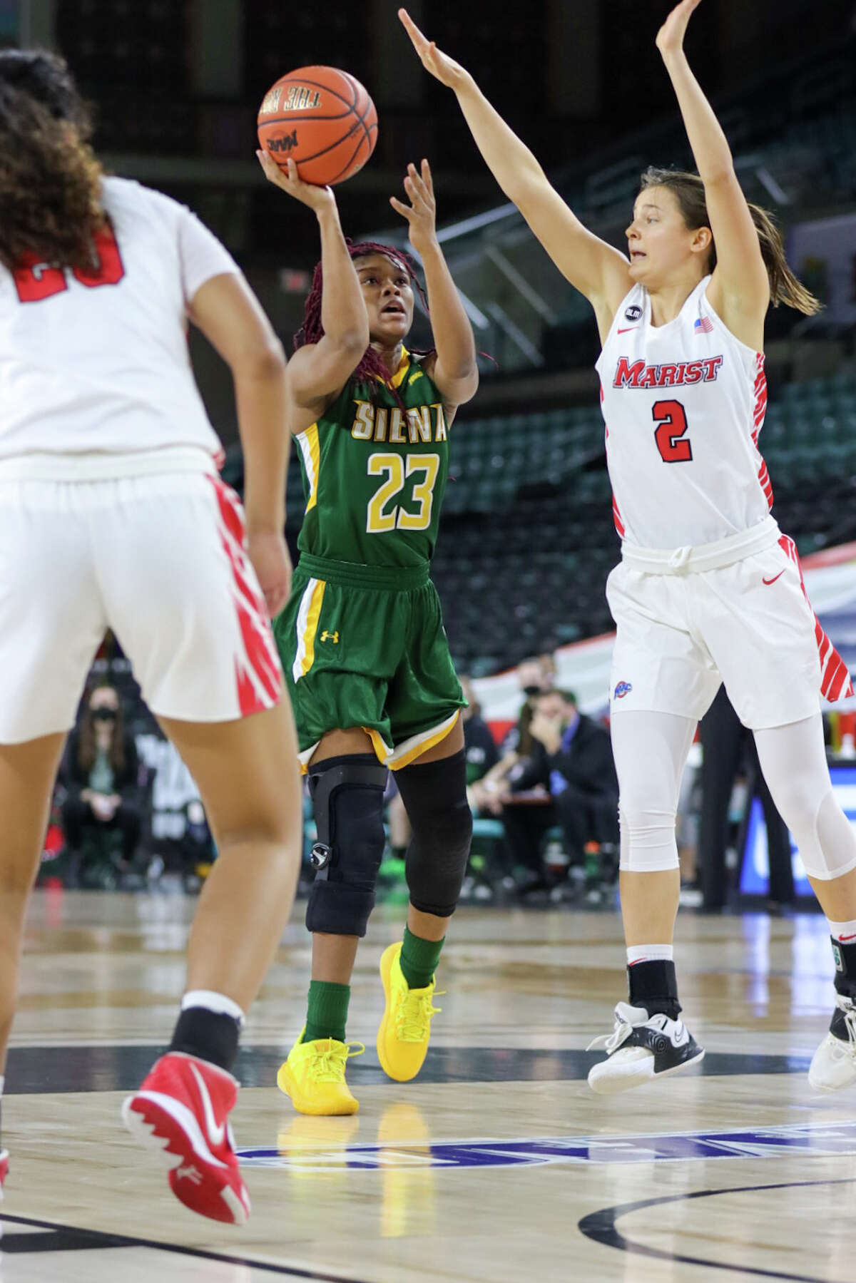 Siena's Isis Young puts up a shot in from of Marist's Allie Best in their MAAC Tournament quarterfinal on Wednesday, March 10, 2021. Young finished with 11 points.