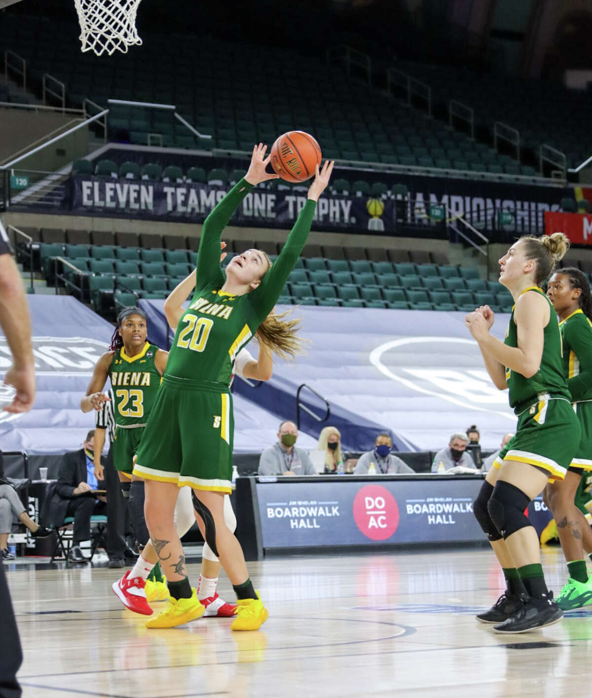 Siena's Margo Peterson grabs a rebound in their MAAC Tournament quarterfinal on Wednesday, March 10, 2021. Peterson led Siena with 13 points.