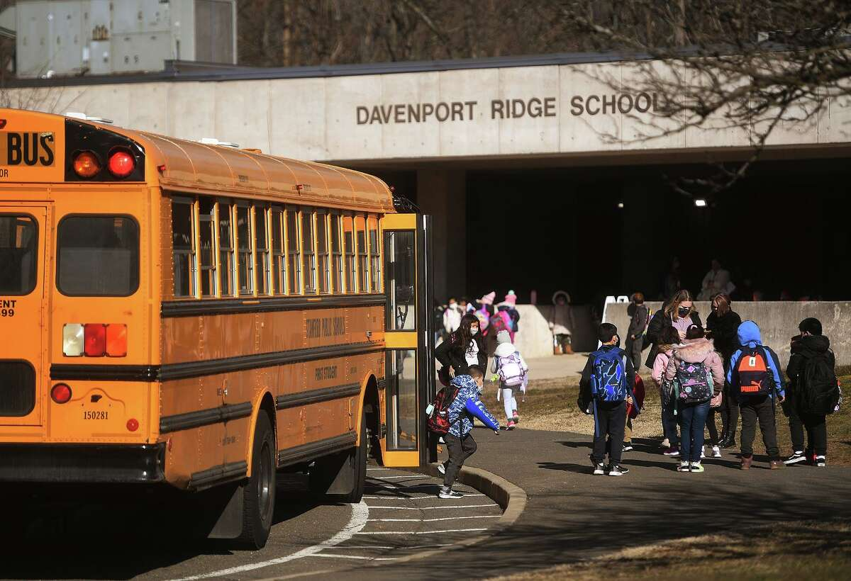 Students flood in for the first day of return to full-time in-person learning at Davenport Ridge Elementary School in Stamford, Conn. on Wednesday, March 10, 2021.