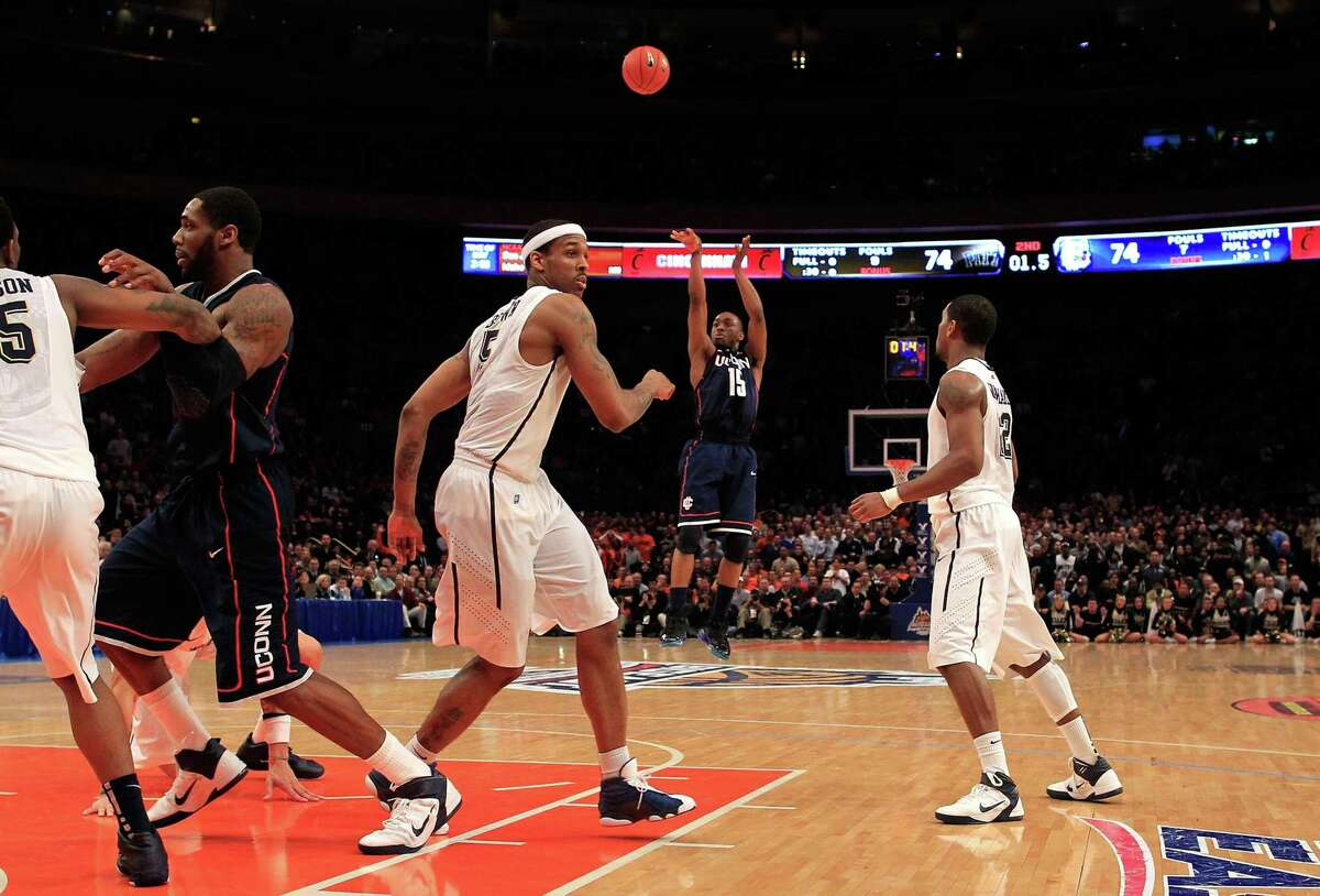 UConn's Kemba Walker shoots the game-winning basket against Pitt during the quarterfinals of the Big East Tournament at Madison Square Garden on March 10, 2011.