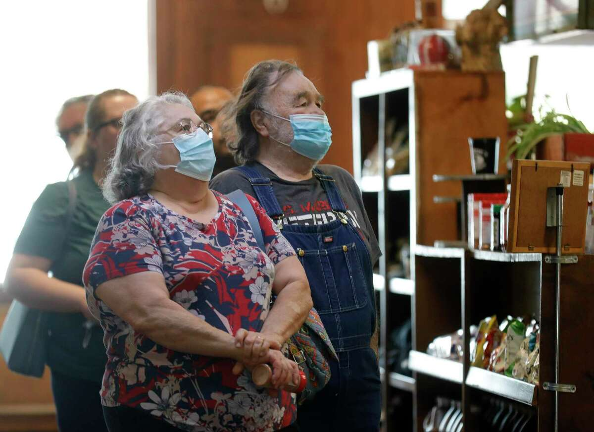 Betty Chandler, left, wears a face mask beisde her brother, Joe Johnson, as they wait in line to order at Mckenzie's Barbeque, Wednesday, March 10, 2021, in Conroe. Gov. Greg Abbott's mask order was lifted Wednesday and allowed businesses and facilities to open to 100% capacity.