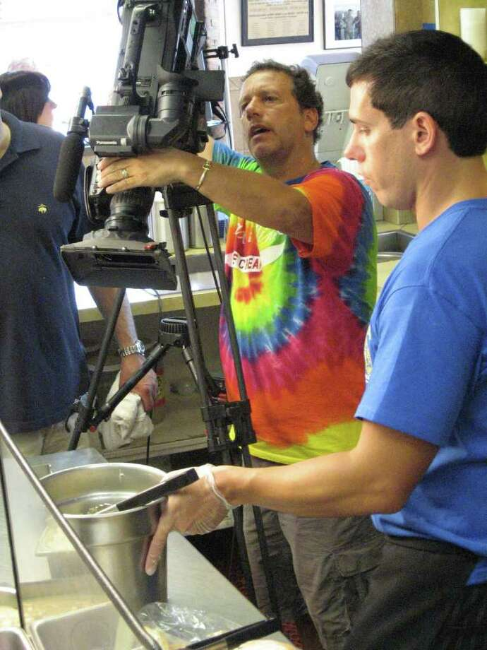 """Food Network's Production Director Tony Pagano, left, was at the Merritt Canteen with his crew Tuesday morning to tape a segment for the show, """"Diners, Drive Ins and Dives."""" Here, he's with restaurant owner Jay Rodriguez. Photo: John Burgeson / Connecticut Post"""