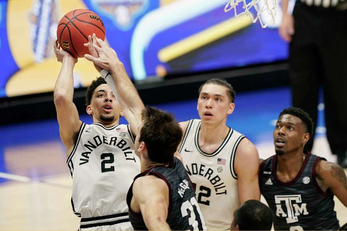 Vanderbilt's Scotty Pippen Jr. (2) shoots against Texas A&M's Luke McGhee (31) in the first half of an NCAA college basketball game in the Southeastern Conference Tournament Wednesday, March 10, 2021, in Nashville, Tenn. (AP Photo/Mark Humphrey)