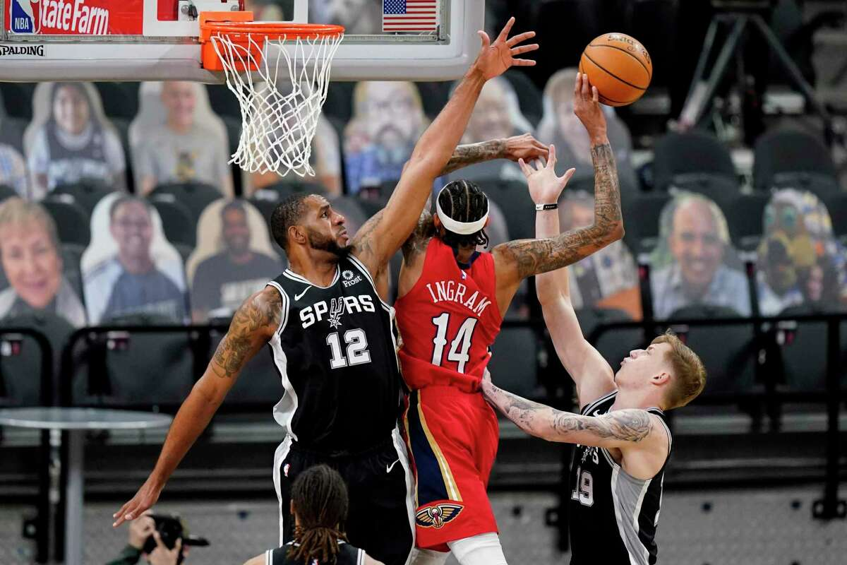 Spurs center LaMarcus Aldridge (12) and Luka Samanic guard against Pelicans forward Brandon Ingram in during the first half on Feb. 27. Aldridge's move to the bench in the three games before the All-Star break was a sign his time with the team was limited.