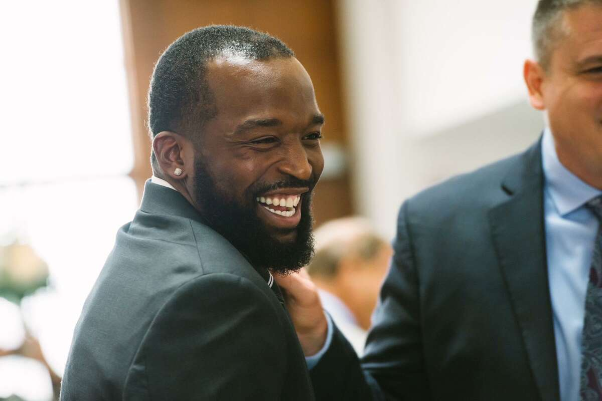 In this undated photo, Xavier Roberson, 31, laughs with another man. Roberson was a basketball player and rapper from Houston's Third Ward. He was shot and killed early Monday, March 8, 2021, in Houston. No arrests have been made.