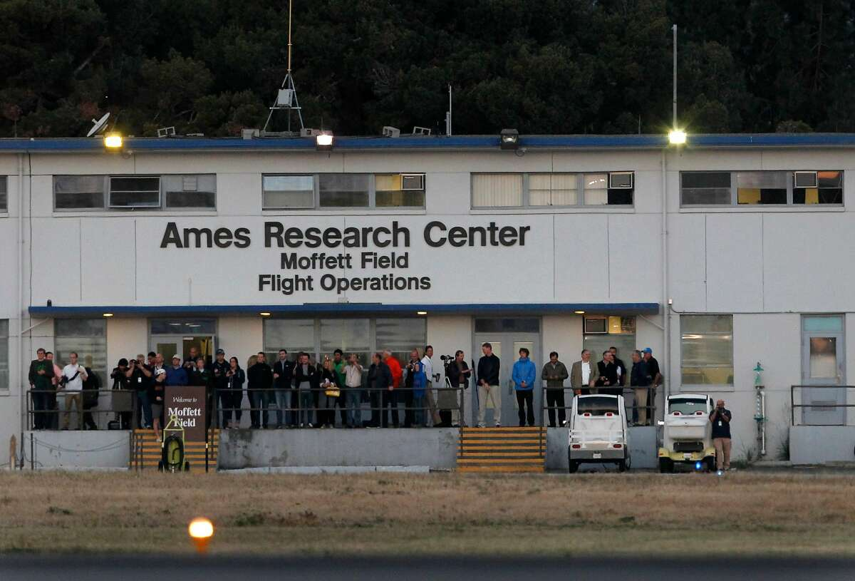 This 2003 file photo shows NASA employees at Moffett Field in Mountain View. NASA said Wednesday it is assessing Moffett Field as a location for a possible shelter for unaccompanied migrant children.