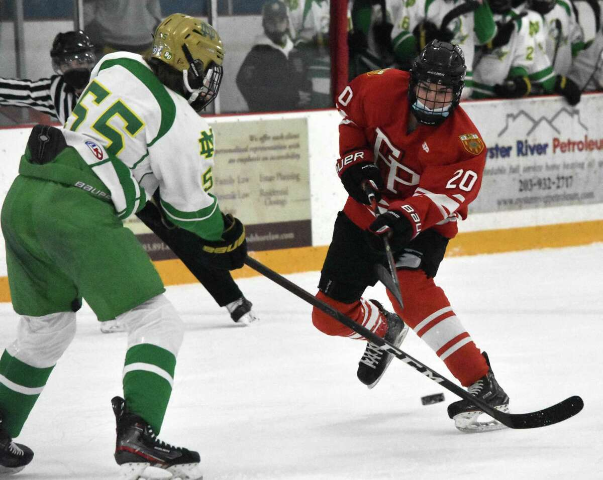 Fairfield Prep's Tiernan Curley takes a shot against Notre Dame-West Haven during an ice hockey game /