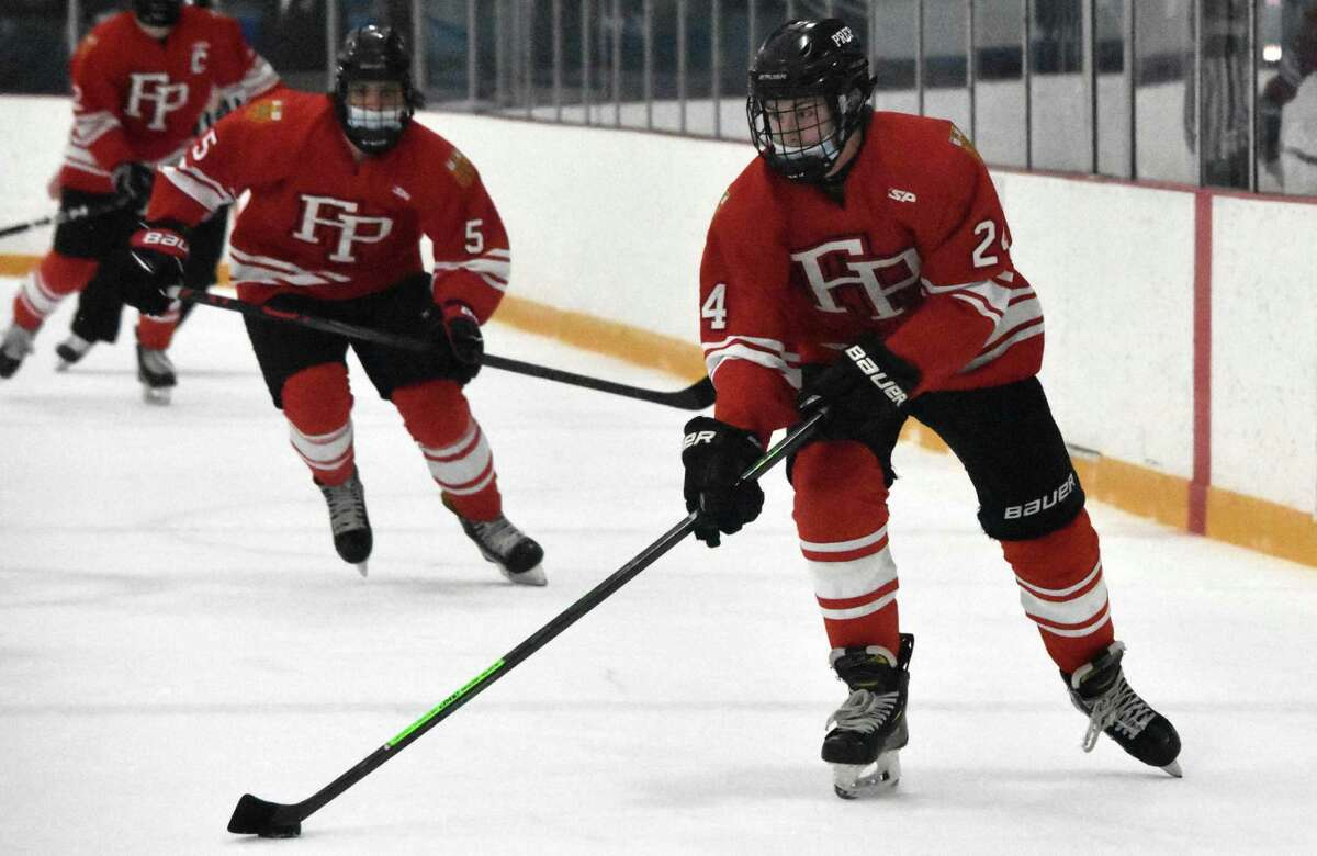 Fairfield Prep's Will Huntington skates with the puck against Notre Dame-West Haven during an ice hockey game at Bennett Rink, West Haven on Wednesday, March 10, 2021.