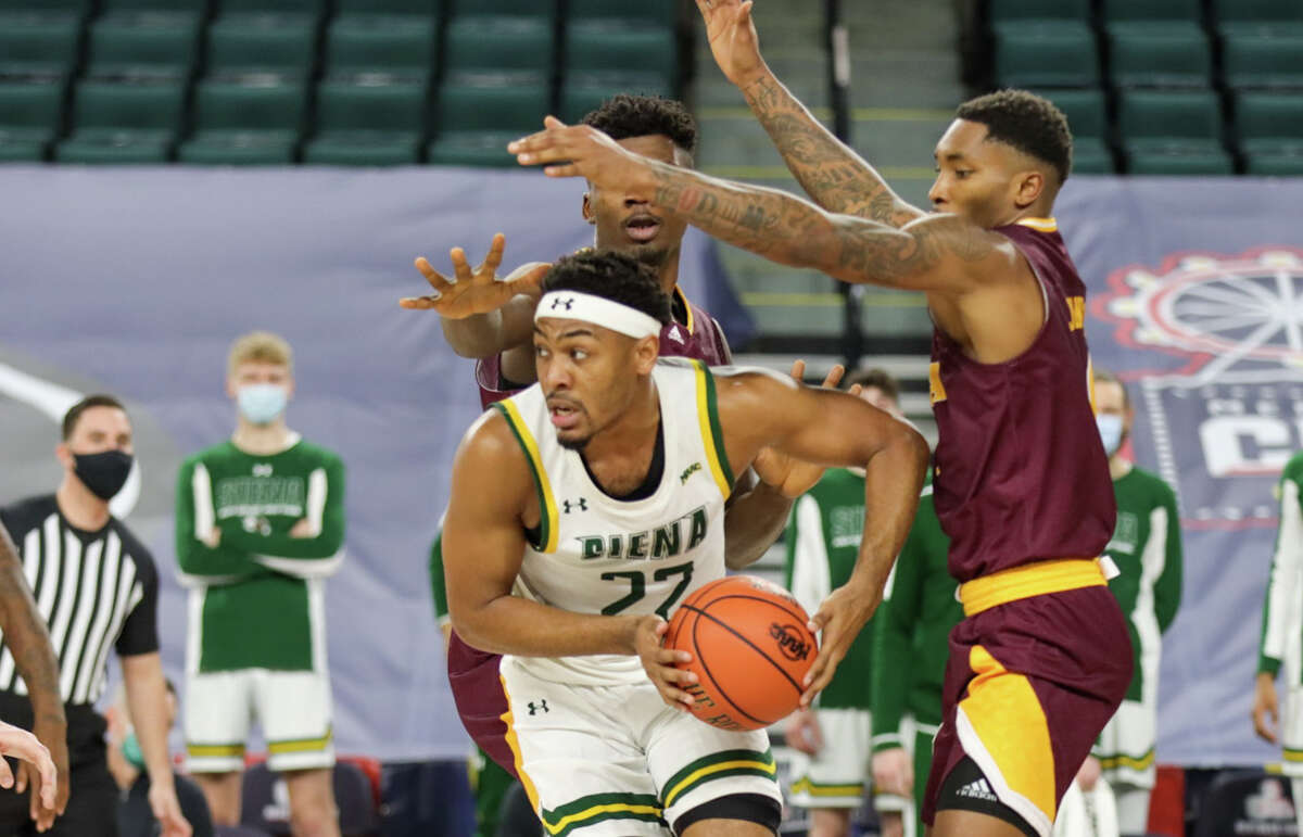 Jalen Pickett of Siena looks to get away from a pair of Iona defenders during their MAAC Tournament quarterfinal Wednesday at Boardwalk Hall in Atlantic City, N.J. Pickett has decided to move on from Siena and entered the NCAA transfer portal.
