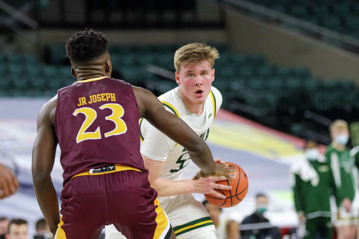 Siena's Jackson Stormo, who led the Saints with 14 points, goes up against Iona's Nelly Junior Joseph during their MAAC Tournament quarterfinal Wednesday at Boardwalk Hall in Atlantic City, N.J.