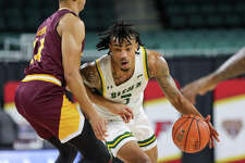Siena's Manny Camper attempts to dribble around Iona's Dwayne Koroma during their MAAC Tournament quarterfinal Wednesday at Boardwalk Hall in Atlantic City, N.J.