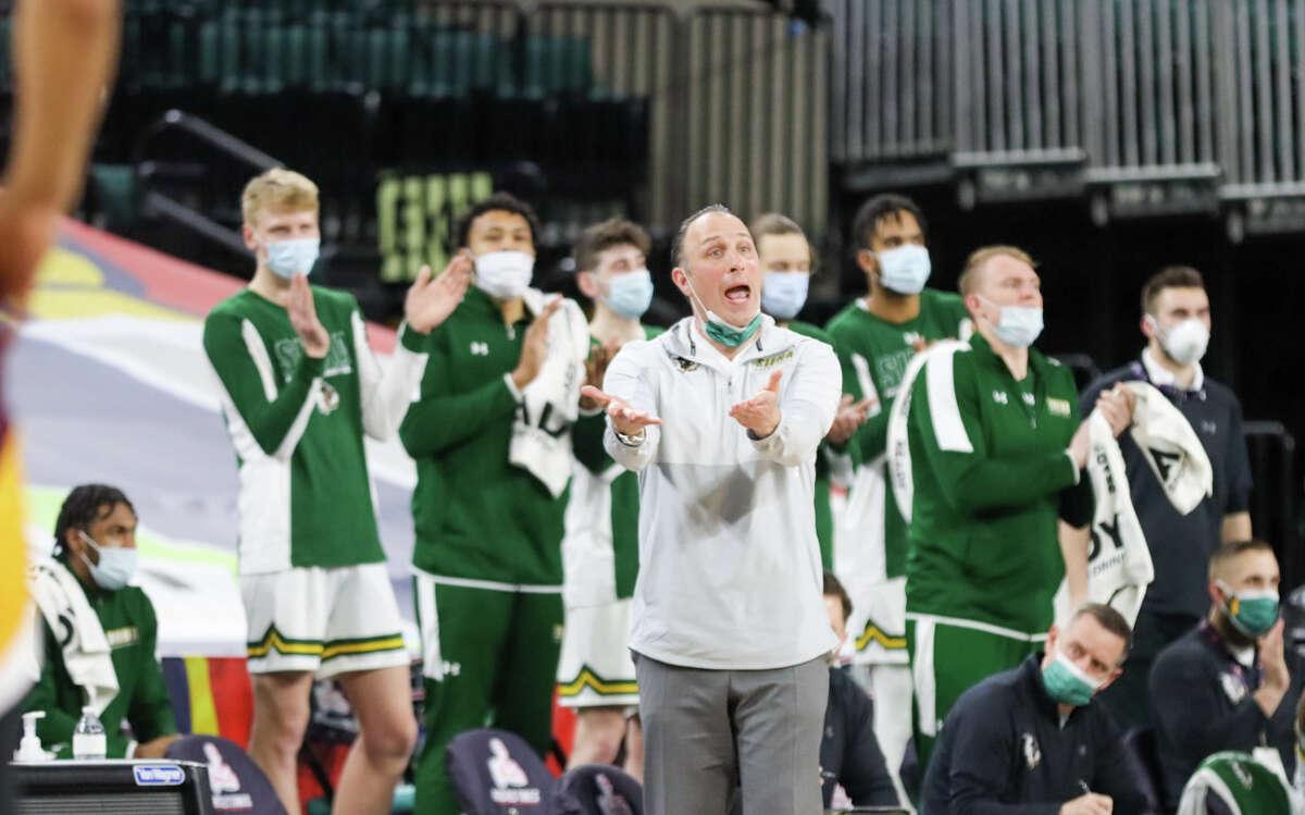 Siena men's basketball coach Carmen Maciariello exhorts his team during their MAAC Tournament quarterfinal against Iona on Wednesday at Boardwalk Hall in Atlantic City, N.J.