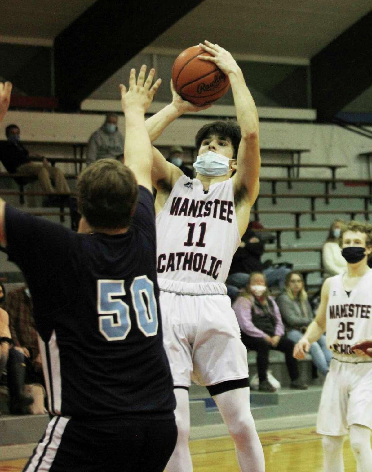 Manistee Catholic Central senior Mateo Barnett elevates for a shot Wednesday against Brethren. (Dylan Savela/News Advocate)