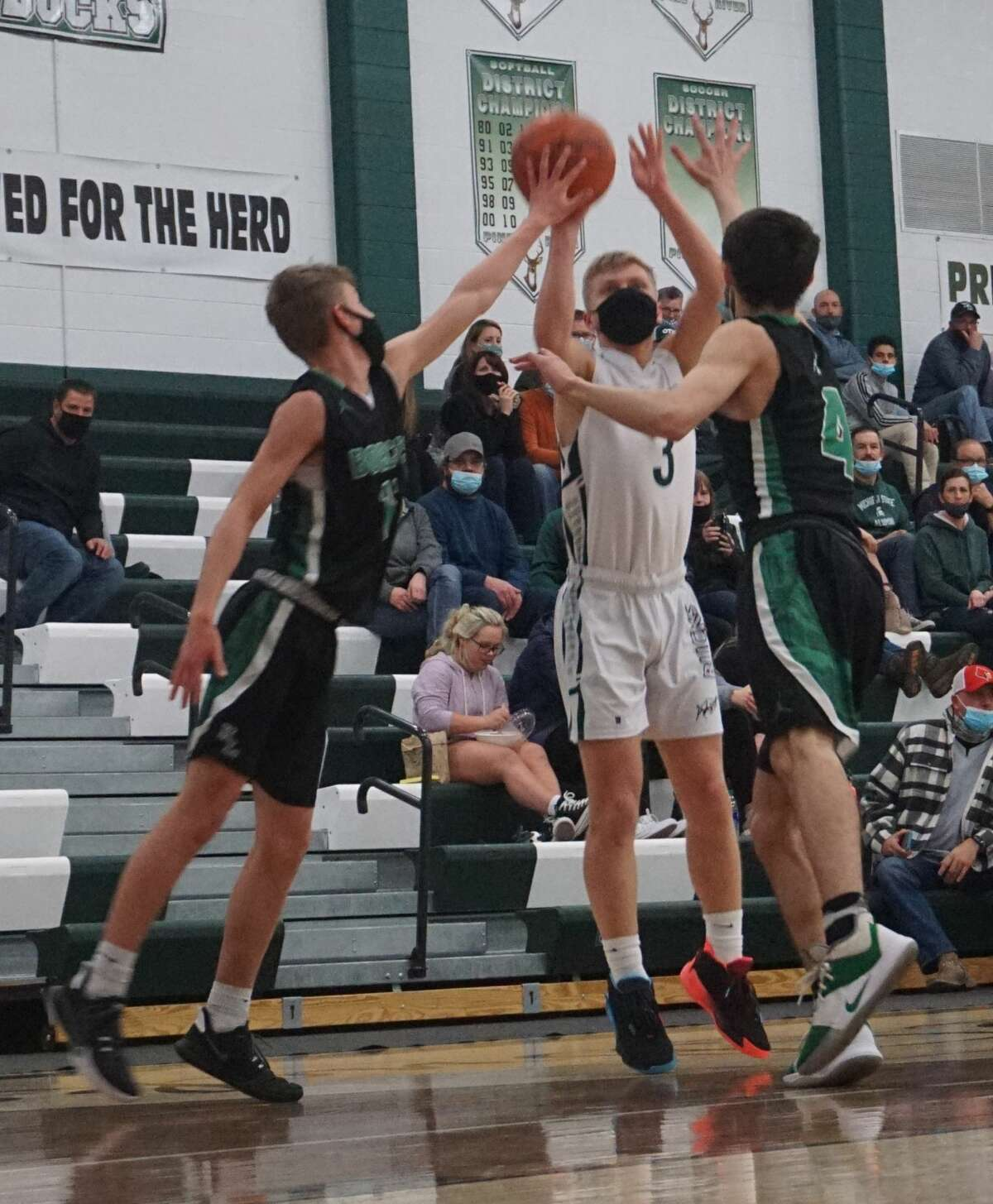 The Pine River boys' basketball team was defeated on its home court against Houghton Lake on Wednesday evening.