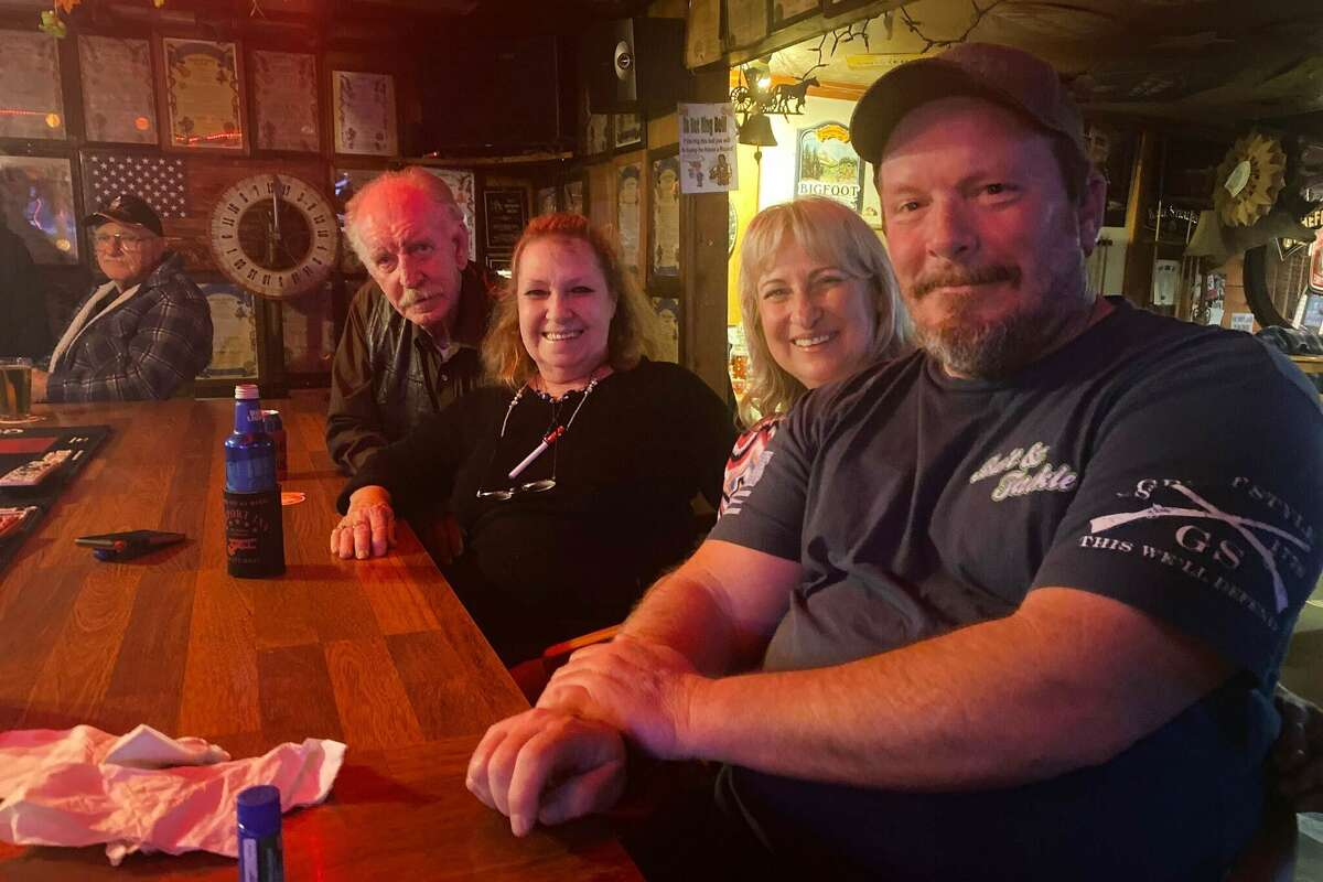 Tom Nelson, Robbie Nelson, Suzanne Hicks and Gordon Hicks hanging out at Airport Bar on a Saturday night.