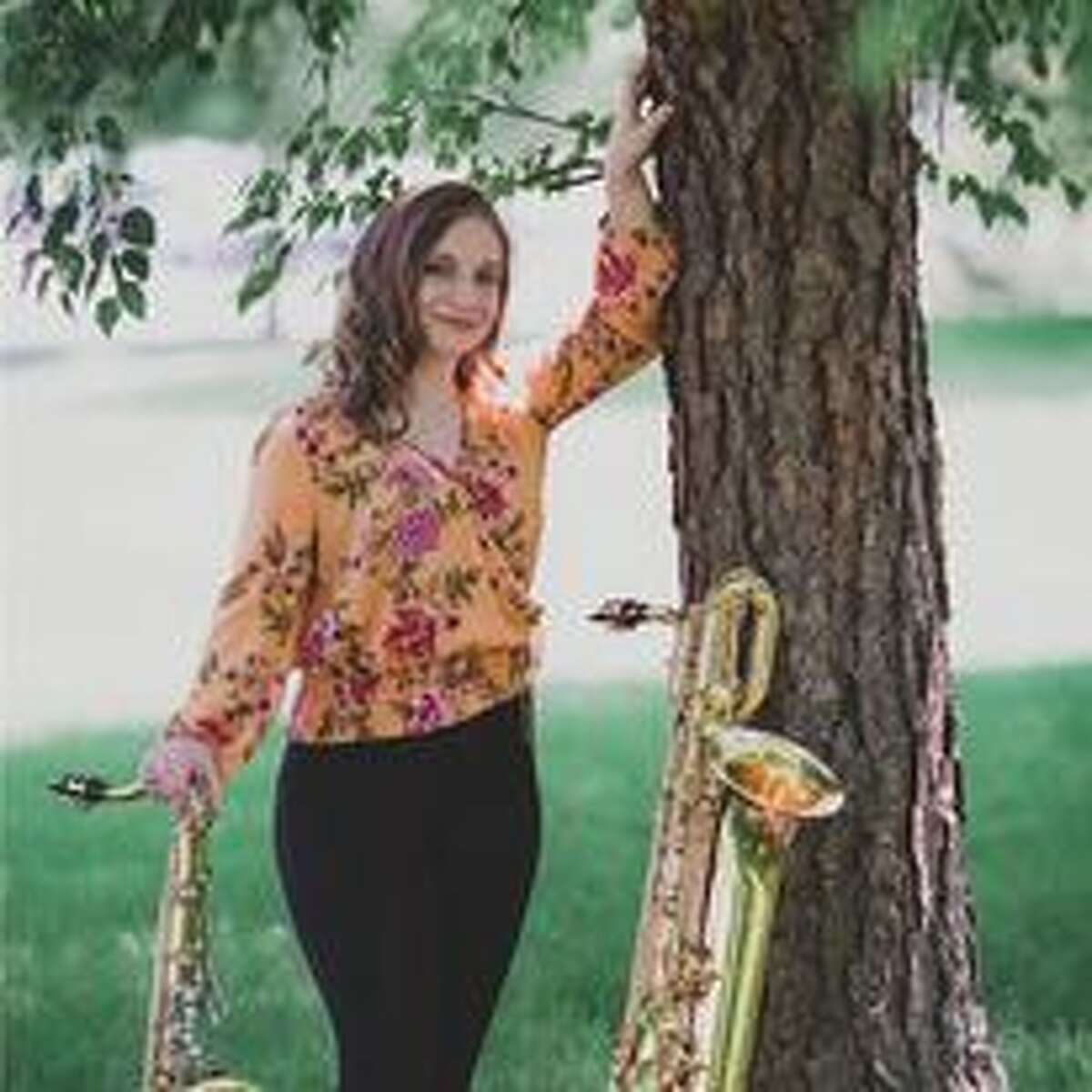Lauren Carter is pictured with her tenor saxophone, left, and her baritone saxophone.