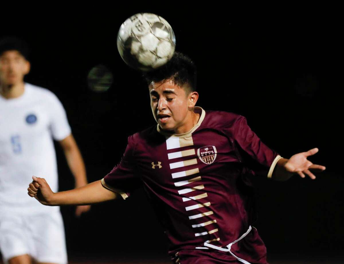 Magnolia West's Hector Chaparro (19) heads the ball during the first period of a District 19-5A high school soccer match at Magnolia West High School, Wednesday, March 10, 2021, in Magnolia.