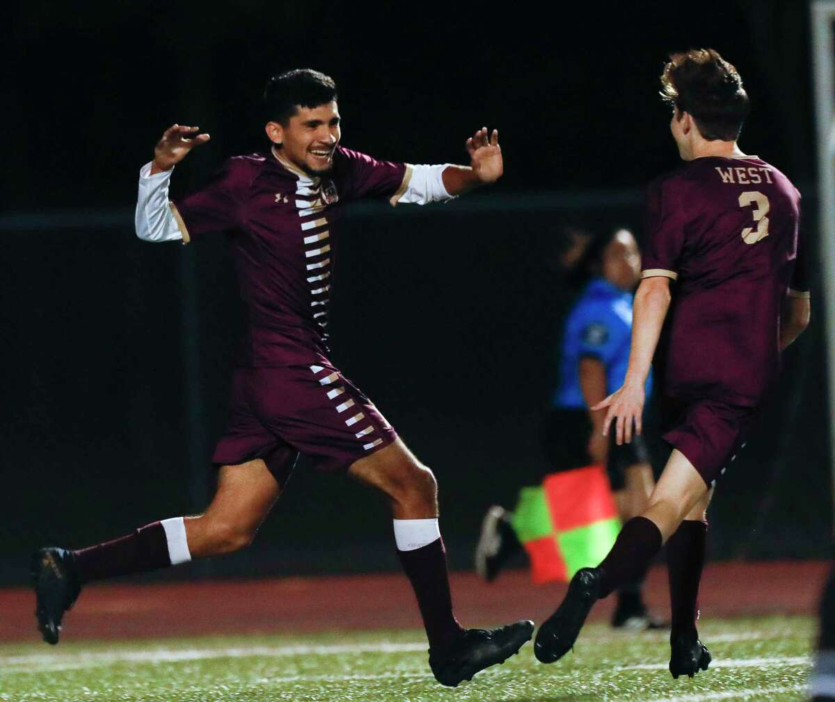 Magnolia West's Fernando Campos (11) reacts after scoring a goal during the first period of a District 19-5A high school soccer match at Magnolia West High School, Wednesday, March 10, 2021, in Magnolia.