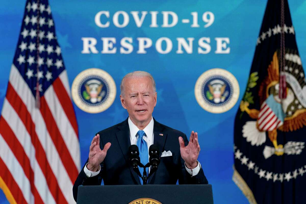 In the March 10, 202, photo, President Joe Biden speaks in the South Court Auditorium in the Eisenhower Executive Office Building on the White House Campus in Washington.