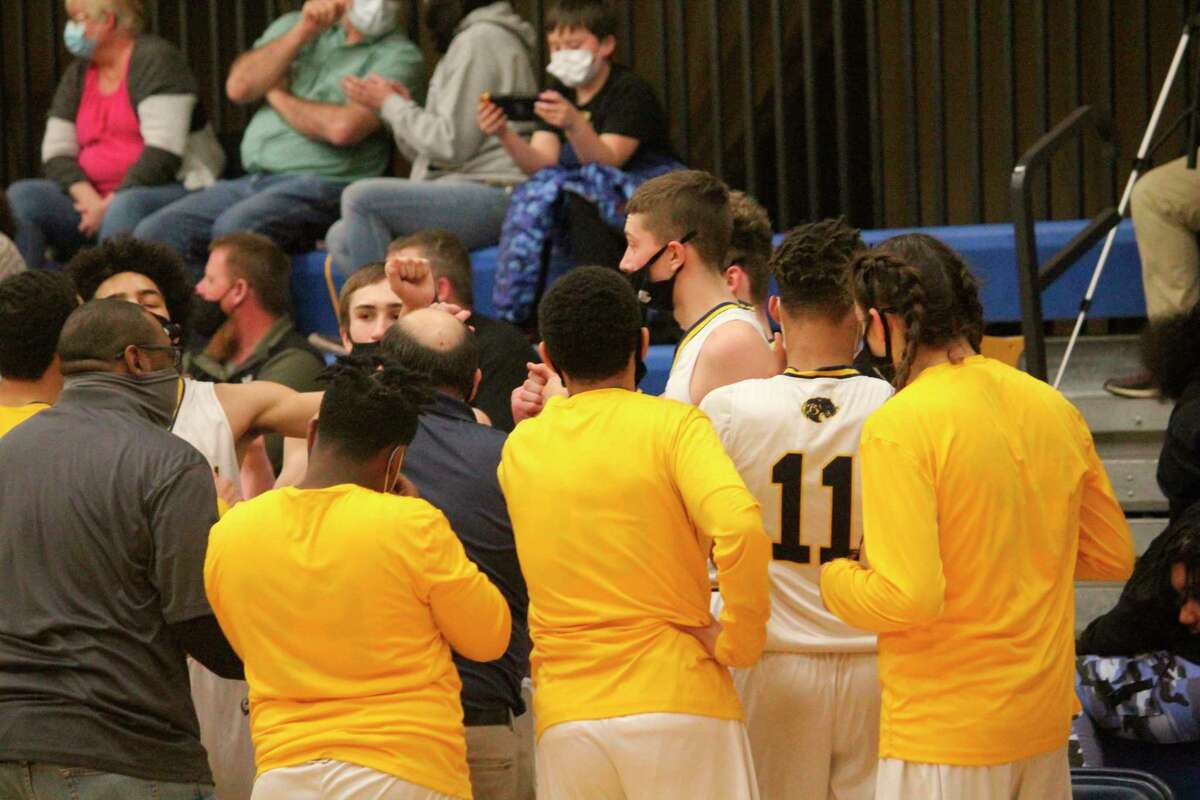 Baldwin players gather in huddle during the Mesick game on Thursday. (Star photo/John Raffel)