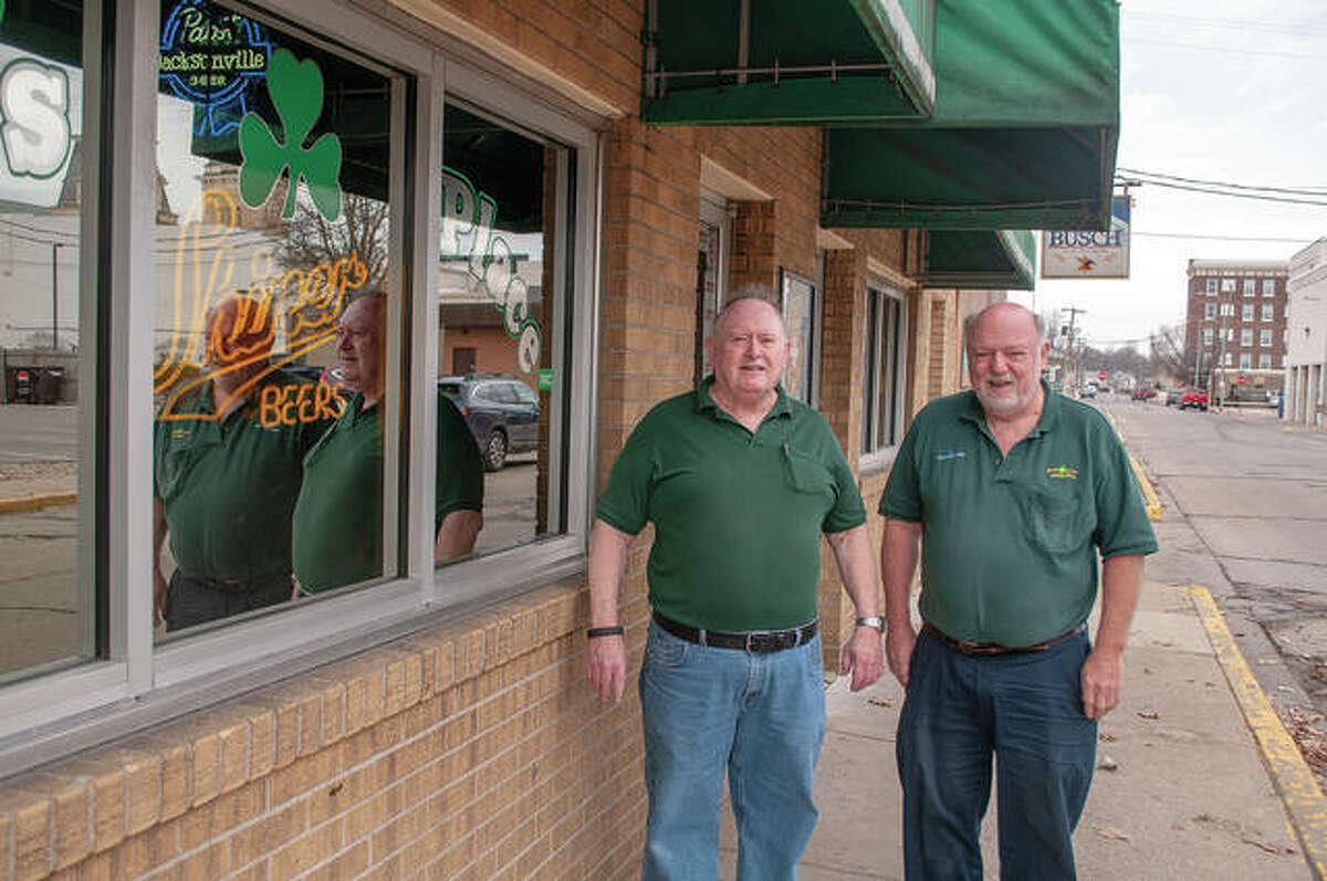 Jim Duncan (left) and Dan Kindred stand Tuesday in front of Don's Place. Duncan will be the parade marshal for Saturday's St. Patrick's Day parade in downtown Jacksonville. He was supposed to lead last year's parade, but it was canceled because of the COVID-19 pandemic.