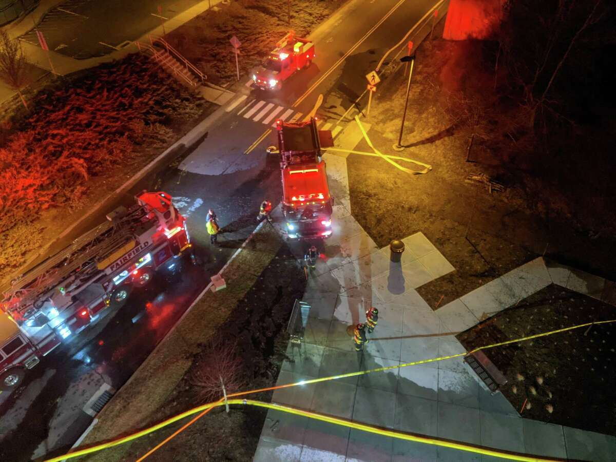 Crews at the scene of a fire on the rooftop deck of the Alto Fairfield Metro Complex on Kings Highway in Fairfield, Conn., on March 10, 2021.