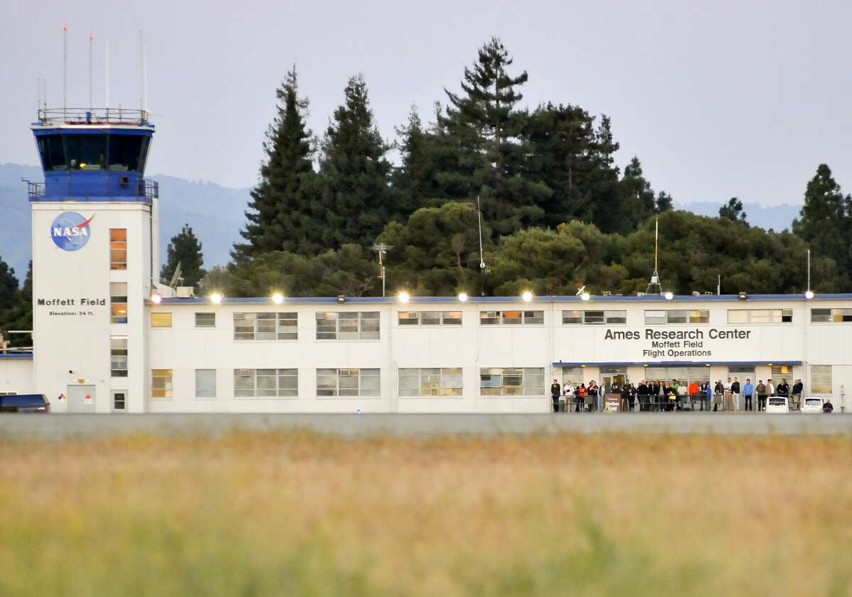 FILE - A crowd gathers to watch the Solar Impulse plane takeoff at Moffett Field NASA Ames Research Center in Mountain View, California on May 3, 2013.