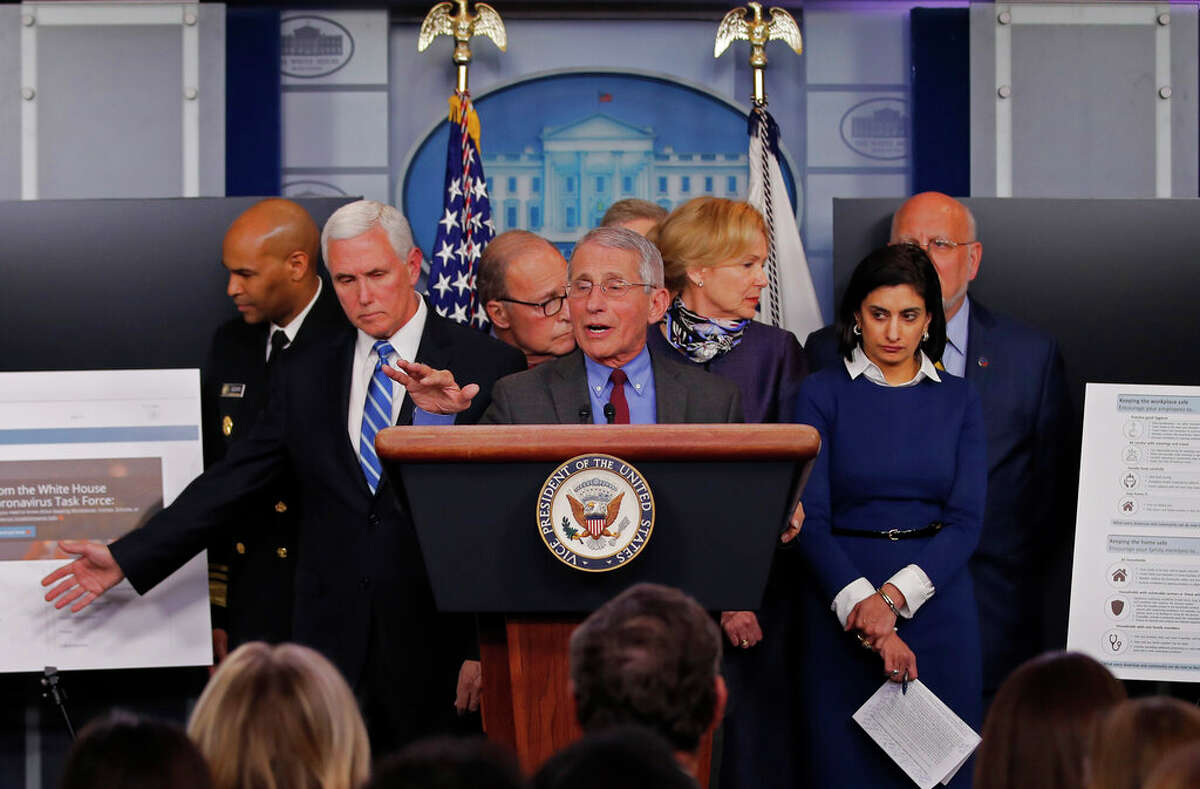 Dr. Anthony Fauci, director of the National Institute of Allergy and Infectious Diseases speaks in the briefing room of the White House in Washington, Tuesday, March, 10, 2020, about the coronavirus outbreak as Vice President Mike Pence, second from left gestures to a display. Also onstage from left are U.S. Surgeon General Jerome Adams, Pence, White House chief economic adviser Larry Kudlow, Fauci, Dr. Deborah Birx, White House coronavirus response coordinator, Administrator of the Centers for Medicare and Medicaid Services Seema Verma, and Dr. Robert Redfield, director of the Centers for Disease Control and Prevention. (AP Photo/Carolyn Kaster)