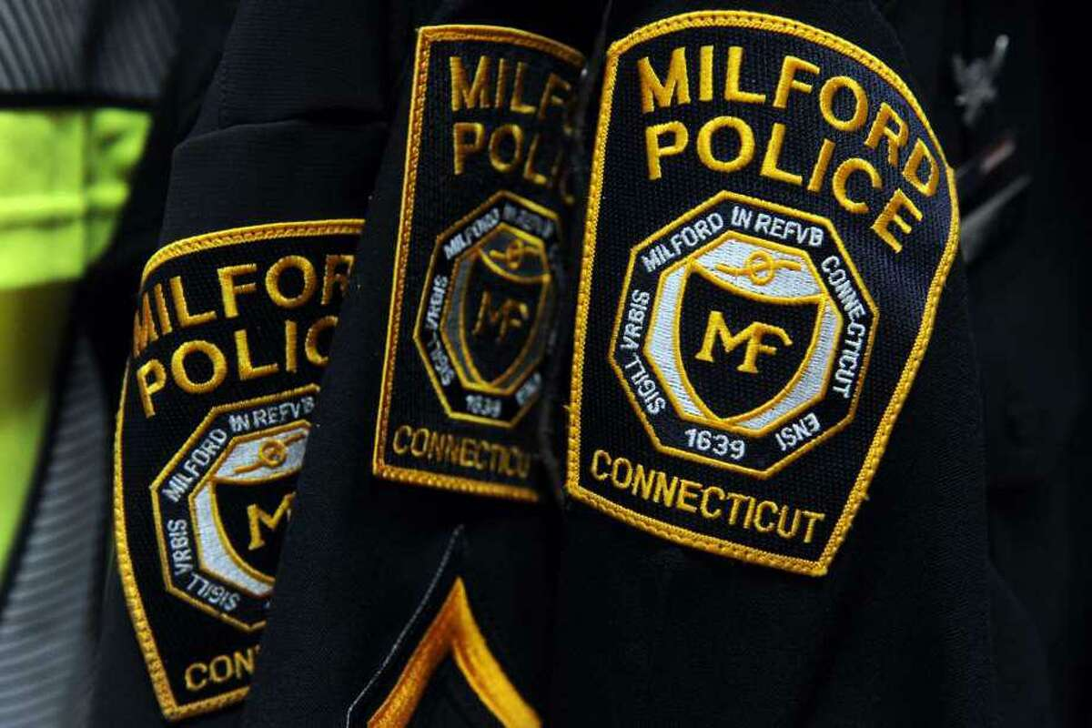 Two Milford residents have been charged in connection with an accidental shooting that seriously wounded a woman last summer.