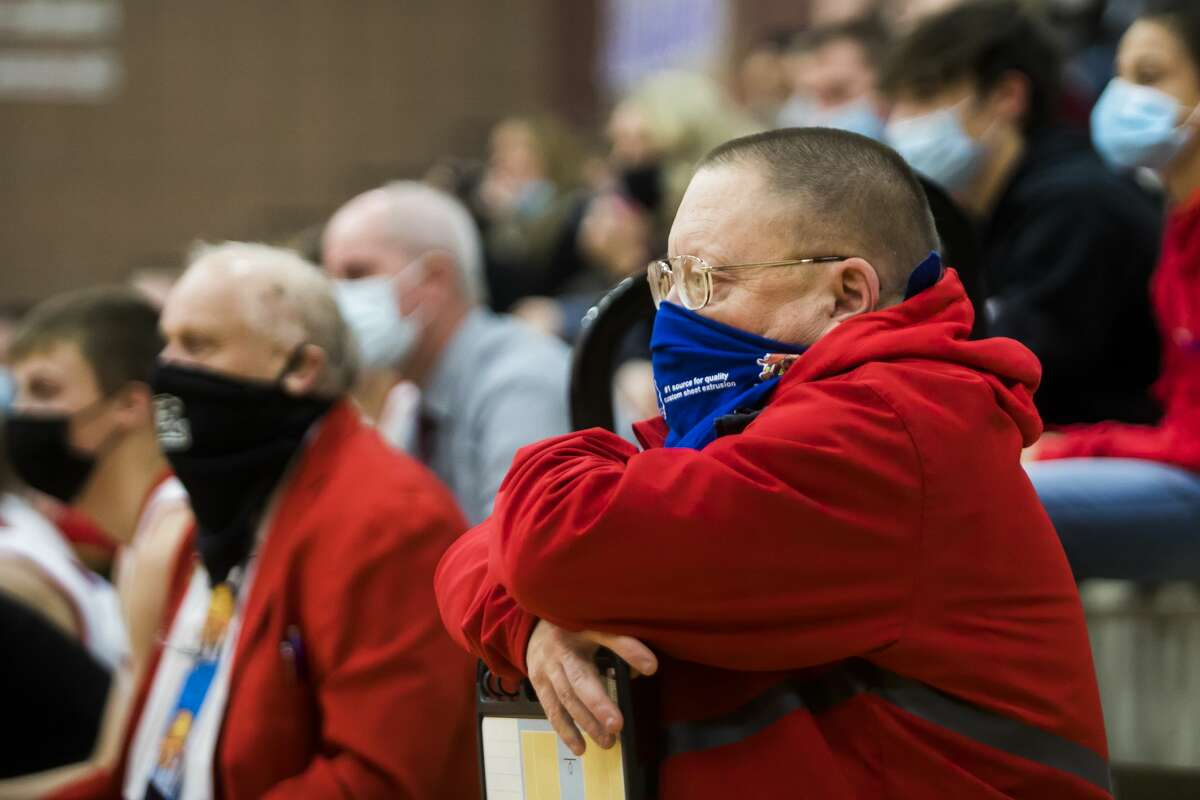 Beaverton boys' basketball manager Allen Friday watches a game against Clare on March 1, 2021.