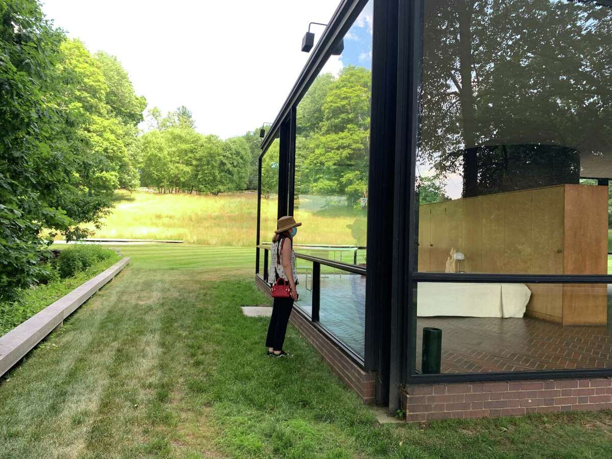 Noelle Newelle peers into the Glass House in New Canaan, which will be opening after the Planning and Zoning Commission approved their plans. Photo was contributed March 2021.