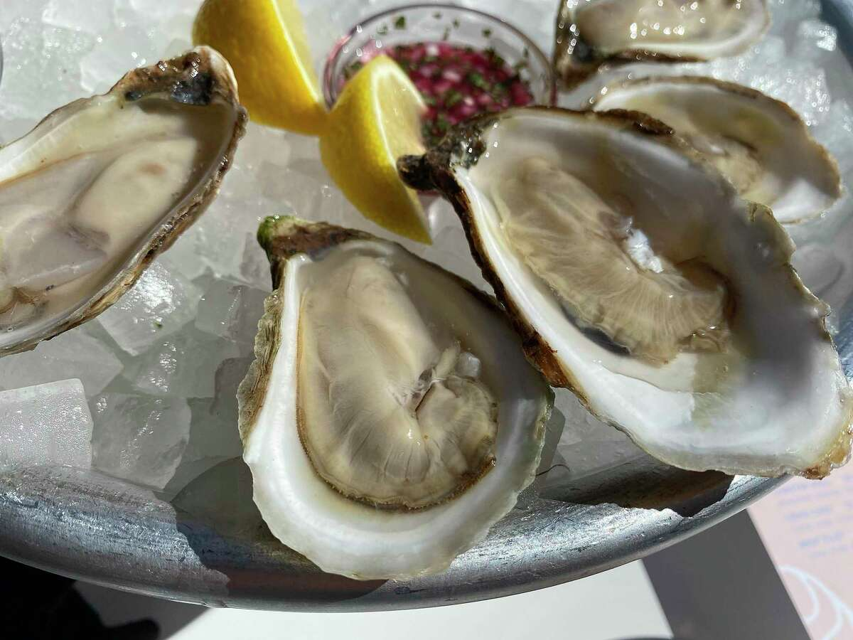 Fresh East Coast oysters in a charming cottage-style setting define Little Em's Oyster Bar in San Antonio's King William Historic District.
